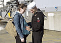 US Navy 060406-N-8825R-021 Fire Controlman 2nd Class Jonathan Brandenburg says good-bye to his wife on the pier to getting underway aboard the guided-missile destroyer USS Momsen (DDG 92).jpg