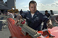 US Navy 060607-N-9851B-013 Aviation Structural Mechanic 1st Class Tony Guerrero assigned to Commander, Fleet Activities Okinawa Drone Detachment, attaches an eye to connect a BQM-74E aerial target to a crane aboard USS Tortuga.jpg