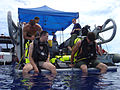 US Navy 061010-N-7473W-029 Lt. j.g. Tyler Y. Smith and Navy Diver 3rd Class Zach D. Dimare, from USS Safeguard (ARS 50) inspect their diving gear and test communications prior to entering the water.jpg