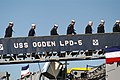 US Navy 070221-N-6410J-226 Enlisted Sailors aboard USS Ogden (LPD 5) prepare to man the rails for the last time during the ship's decommissioning ceremony.jpg