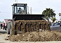 US Navy 070305-N-7575W-107 Equipment Operator Constructionman Crystal Epling, assigned to Naval Mobile Construction Battalion (NMCB) 4, operates a front-end loader during the groundbreaking of the new Seabee Museum.jpg
