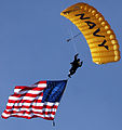 US Navy 070308-N-4163T-189 A member of the U U.S. Navy Parachute Demonstration Team Leap Frogs descends into San Diego's Qualcomm Stadium with the American flag during a training session.jpg