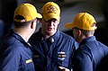 US Navy 070404-N-7130B-448 Following a successful general quarters drill aboard the Nimitz-Class aircraft carrier USS Ronald Reagan (CVN 76), Senior Chief Sonar Technician (Surface) Daniel Boyer, from San Diego, debriefs fellow.jpg