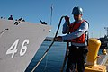 US Navy 070731-N-7431W-001 Seaman Joey Frazzio, assigned to Port Operations at Naval Station (NAVSTA) Everett, assists as line handler in the departure of the guided-missile frigate USS Rentz (FFG 46) in preparation for the shi.jpg