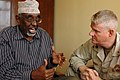 US Navy 070827-A-4381M-001 Cmdr. Walter Dinkins, Combined Joint Task Force-Horn of Africa (CJTF-HOA) command chaplain, meets with the Minister of Islamic Affairs and Wafti of Djibouti, Mogeuh Dirir Samatar.jpg
