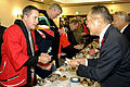 US Navy 071027-N-7883G-050 Cmdr. Dan Dusek, commanding officer of USS Fitzgerald (DDG 62), exchanges business cards with Muroran Mayor Masashi Shingu during a reception held in the Japanese Steel Works reception hall.jpg
