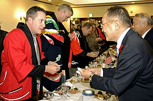 Japan Steel Works - Image: US Navy 071027 N 7883G 050 Cmdr. Dan Dusek, commanding officer of USS Fitzgerald (DDG 62), exchanges business cards with Muroran Mayor Masashi Shingu during a reception held in the Japanese Steel Works reception hall