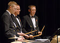 US Navy 080211-N-0773H-061 Musicians 1st class Jason W. Niehoff, left, Curt R. Duer and John J. Martinich, all members of the percussion section, perform on stage during a concert presented at Great Mills High School.jpg