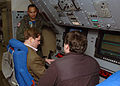 US Navy 080214-N-2491R-122 Aviation Systems Warfare Operator 2nd Class Manuel Castro, assigned to the Mad Foxes of Patrol Squadron (VP-5), shows members of a Congressional Staff the sensor 1 and sensor 2 operator stations.jpg