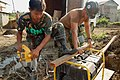 US Navy 080608-N-7498L-488 Pfc. Joseph Lumagod, assigned to the Armed Forces of the Philippines 546th Engineer Construction Battalion, assists Builder 3rd Class Zachary Fiorey, assigned to Naval Mobile Construction Battalion (N.jpg