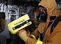 US Navy 080827-N-0807W-092 Mineman 3rd Class Wes Akin performs an equipment test on the naval firefighting thermal imager.jpg
