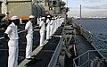 US Navy 090203-N-3316L-041 Sailors man the rails of USS Nashville (LPD 13).jpg