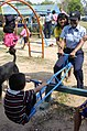 US Navy 090316-M-9292S-004 U.S. Navy Aircraft Administrator 3rd Class Tanya R. Williams, assigned to Fixed Wing Fighter Attack Squadron 27, plays with a student at the Ban Lam Nang Keaw elementary school as part of the humanita.jpg