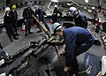 US Navy 090402-N-7478G-232 Sailors aboard the amphibious command ship USS Blue Ridge (LCC 19) unhook the chain stopper from the anchor chain before dropping anchor in Tokyo Bay.jpg