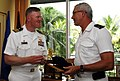 US Navy 090527-N-4047W-264 Cmdr. John Wade, commanding officer of the guided-missile destroyer USS Preble (DDG 88), left, exchanges gifts with Rear Adm. Jean Louis Vichot.jpg