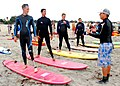 US Navy 090729-N-6326B-029 Steven McManus, right, from Coronado Surfing Academy, teaches basic surfing to amputee participants and physical therapists from the 2009 Military Amputee Advanced Skills Training (MAAST) workshop.jpg