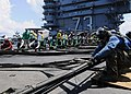 US Navy 090821-N-1062H-026 Sailors aboard USS George Washington (CVN 73) prepare to raise the Ready-Jet aircraft barricade while conducting a flight deck drill.jpg