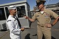 US Navy 090827-N-9818V-005 Master Chief Petty Officer of the Navy (MCPON) Rick West speaks with a Sailor from the USS Constitution before attending a heritage training formal dinner aboard the USS Constitution for the chief pet.jpg
