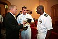 US Navy 090904-N-3271W-024 Ensign Dewayne Thomas and Chief Missile Technician Chad Ownbey, both assigned to the guided-missile submarine USS Ohio (SSGN-726), present Ohio Governor Ted Strickland with a command ball cap.jpg