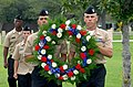 US Navy 090911-N-4981W-131 Chief petty officer selects from the Naval Construction Battalion Center present a wreath in tribute to the victims of the Sept. 11, 2001 terrorist attacks.jpg