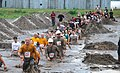 US Navy 090912-N-6272M-077 Runners make their way through muddy obstacles during the 2009 Seabee Mud Run at Naval Construction Battalion Center Gulfport.jpg