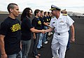 US Navy 090919-N-6220J-009 Rear Adm. Mark Fox, commander of the Naval Strike and Air Warfare Center, congratulates Delayed Entry Program enrollees after conducting their swearing-in ceremony at the Reno Air Races.jpg