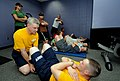 US Navy 100504-N-5208T-010 Crew member demonstrate the proper Navy sit-up during a SEAL Fitness Challenge at the Birmingham YMCA.jpg
