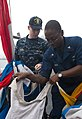 US Navy 100701-N-5319A-019 Quartermaster 1st Class Martez Smith and Ensign Andrew Norris prepare signal flags during flag signaling drills.jpg