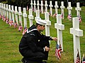 US Navy 110529-N-PE140-126 Ship's Serviceman 1st Class Samuel Hernandez-Moreno pays his respects to a fallen service member buried at the Brookwood.jpg