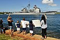 US Navy 110706-N-WP746-364 Families and friends along Aloha Aina Park at Joint Base Pearl Harbor-Hickam welcome home the guided-missile cruiser USS.jpg