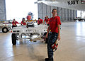 US Navy 110720-N-PP197-006 Aviation Ordnanceman Airman Michelle Boatman hauls an AGM-65 Maverick air-to-ground tactical missile to load on a P-3C O.jpg