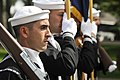 US Navy 110910-N-WP746-331 Operation Specialist 2nd Class Marcos Locero and members of the color guard lead the parade group through the town of Pu.jpg