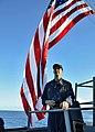 US Navy 111115-N-RI884-100 Cmdr. Michael Ray, commanding officer of the guided-missile destroyer USS O'Kane (DDG 77), observes gunnery exercises du.jpg