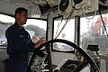 US Navy 111221-N-DI599-050 A Sailor pilots a tug that maneuvers the USS North Carolina.jpg
