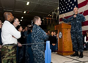 US Navy 120112-N-FI736-019 Chief of Naval Operations (CNO) Adm. Jonathan Greenert speaks to Sailors during an all-hands call aboard the aircraft ca.jpg