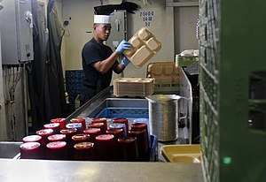 US Navy 120124-N-RG587-210 Airman Eric Jimenez cleans trays in the scullery aboard the Nimitz-class aircraft carrier USS Carl Vinson (CVN 70).jpg
