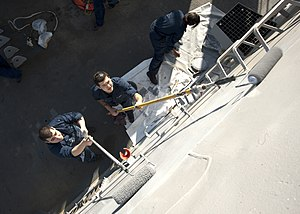 US Navy 120128-N-NL401-006 Sailors aboard the Arleigh Burke-class guided-missile destroyer USS James E. Williams (DDG 95) paint the exterior bulkhe.jpg