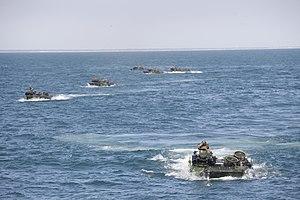 US Navy 120201-M-DK975-034 U.S. Marine Corps amphibious assault vehicles conduct amphibious operations.jpg
