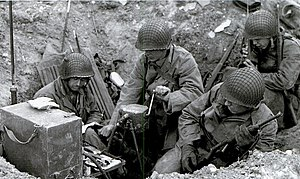 Human power - U.S. soldiers during WWII powering radio set using GN-45 hand crank generator