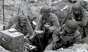 Human power - U.S. soldiers during WWII powering radio set using GN-45 hand crank generator