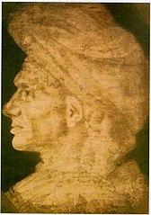 Testa di uomo glabro con turbante