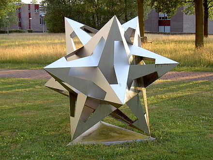 Sculpture of a small stellated dodecahedron, as in Escher's 1952 work Gravitation (University of Twente) Universiteit Twente Mesa Plus Escher Object.jpg
