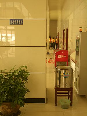 Instant hot water dispenser - Hot water dispenser at Lanzhou Bus Station, China, providing free boiling water to make a cup of tea or a bowl of instant noodles