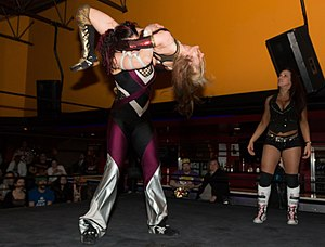 Backbreaker - Vanessa Kraven holds Xandra Bale in the air with a Canadian backbreaker rack.
