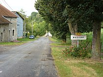Wasigny(Ardennes) city limit sign.JPG