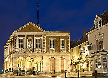 The south side of Windsor Guildhall at night showing Wren's open ground floor and 1829 extension.