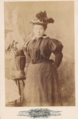 Woman in hat by Elmer Chickering of Boston.png