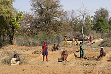 Women working on road repairing, Umaria district, Madhya Pradesh, India.jpg
