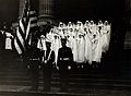 World War One nurses, with arms outstretched, stand with Wellcome V0027504.jpg