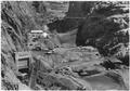 """View looking upstream through Black Canyon showing downstream cofferdam and rock backwash barrier. Excavation in dam... - NARA - 293823.tif"